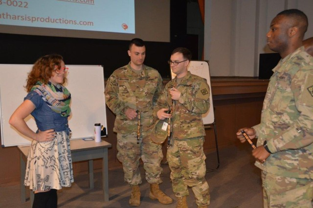 "WIESBADEN, Germany -- Courtney Abbott, senior educator with Catharsis Productions, visits with Soldiers after her ""Beat the Blame Game"" presentation April 10, 2017, at the Tony Bass Auditorium. The interactive presentation was part of Sexual Assault Awareness and Prevention Month and counted toward annual SHARP online training requirements for Soldiers and civilians."