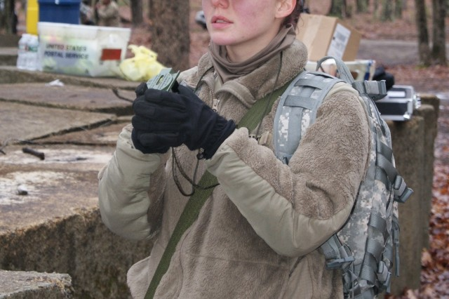 Competitor Spc. Dakota Dugan, with the 198th Army Band, 99th Regional Support Command, uses her compass as part of the land navigation event at Fort Devens, Massachusetts, April 5, 2017, as part of the 2017 Joint 80th Training Command and 99th RSC Best Warrior Competition.