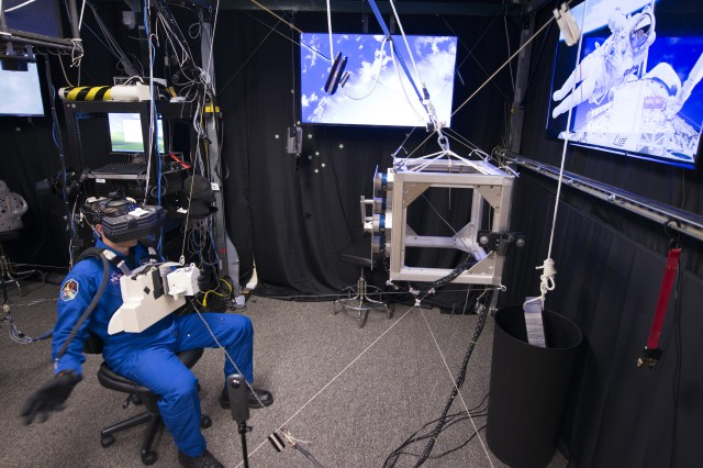 Lt. Col. Drew Morgan, one of two active-duty Army astronauts, uses virtual training equipment to mimic maneuvering outside the International Space Station with a jetpack during training at Johnson Space Center in Houston March 1, 2017. Even if such a spacewalk is one of the most difficult and dangerous tasks to do in space, Morgan said, he'd still jump at the chance to do one in real life.