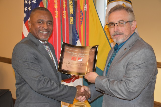 Eugene Collins, deputy assistant secretary of the Army (Environment, Safety and Occupational Health), presents the FY16 Secretary of the Army and Chief of Staff, Industrial Operations Safety Award, to Doyle Wootten, senior safety director, U.S. Army Material Command. Wootten accepted the award on behalf of Red River Army Depot, U.S. Army Material Command. U.S. Army photo by Luis Martinez