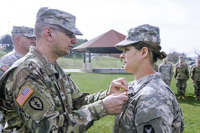 Brig. Gen. Steve Altman, Deputy Commanding General for Maneuver, Iowa National Guard, pins the Iowa National Guard Medal of Merit on Spc. Lauren E. Kopetzky, a Soldier from Company C, 224th Brigade Engineer Battalion, Iowa Army National Guard based in Cedar Rapids, Iowa, during a ceremony at the Camp Dodge Joint Maneuver Training Center, in Johnston, Iowa. Kopetzky was recognized for providing aid to a shooting victim in Ames, Iowa, on August 9, 2016.