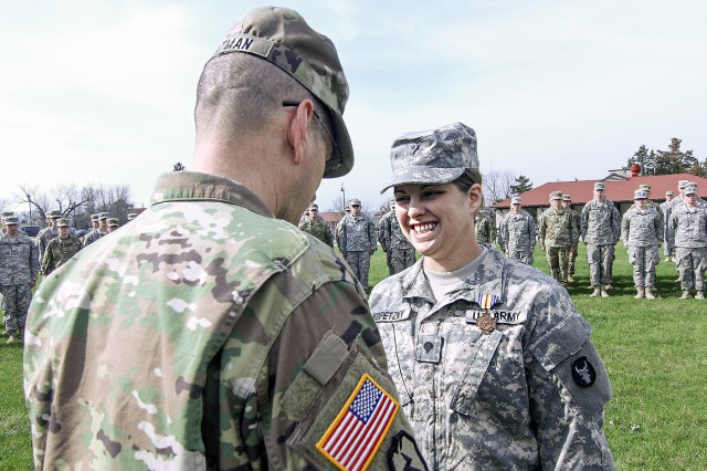 Spc. Lauren E. Kopetzky, a Company C, 224th Brigade Engineer Battalion, Iowa Army National Guard Soldier, based in Cedar Rapids, Iowa, receives the Iowa National Guard Medal of Merit from Brig. Gen. Steve Altman, Deputy Commanding General for Maneuver, Iowa National Guard, on April 9, 2017, during a ceremony at the Camp Dodge Joint Maneuver Training Center, in Johnston, Iowa. Kopetzky was recognized for providing aid to a shooting victim in Ames, Iowa, on August 9, 2016.