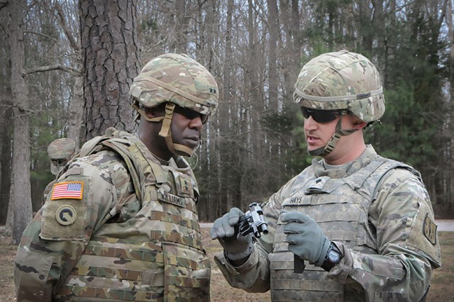 Spc. Stanley Hays, 508th Quartermaster Company, briefs Maj. Gen. Darrell K. Williams, the commanding general of the Combined Arms Support Command and Fort Lee, Virginia, on the 9-millimeter Beretta pistol on March 9, 2017.