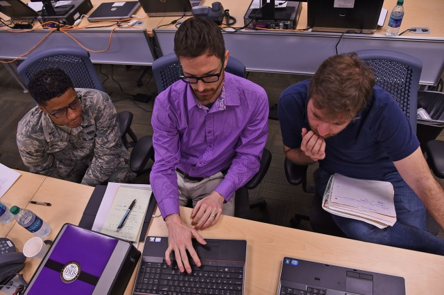 Louisiana Air National Guardsman and Cyber Defense Incident Response Team member 2nd Lt. Anthony Tucker, of New Orleans (left), CLECO employee Jared Hancock, a resident of Alexandria, Louisiana, and Radiance Technologies employee Adam Hellmers, a resident of New Orleans, work together to find simulated hacking attempts on a network in Baton Rouge, Louisiana, March 30, 2017. The Louisiana National Guard used four days during their disaster relief exercises to partner with local power company CLECO to establish a relationship with the company and ensure they are up to speed in cyber defense practices.