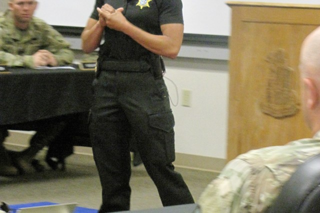 Sgt. Brittany Jackamonis, a nine-year veteran with the Richland County Sheriff Department, speaks during the unit's Women's History Month observance.
