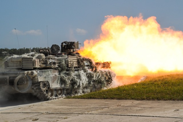 Soldiers fire an M1A2 SEPv2 Abrams Main Battle Tank during exercise Combined Resolve VII at the 7th Army Training Command in Grafenwoehr, Germany, Aug. 18, 2016. They are assigned to 2nd Battalion, 7th Infantry Regiment, 1st Armored Brigade Combat Team, 3rd Infantry Division. Combined Resolve is a U.S.-led combined arms exercise designed to prepare U.S. and European forces for multinational operations. Combined Resolve VII includes more than 3,500 participants from 16 NATO and European partner nations.