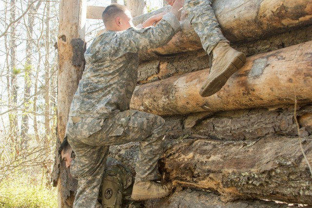 Members of the 105th Engineers Battalion, NC National Guard, clear a vertical obstacle as a team on the X-miler ruck event during the 2017 Sapper Stakes Invitational held at Camp Butner on April 9, 2017. The event brings together the engineer community to build leadership and camaraderie from across the state of North Carolina Guard and Reserve Component engineer units.