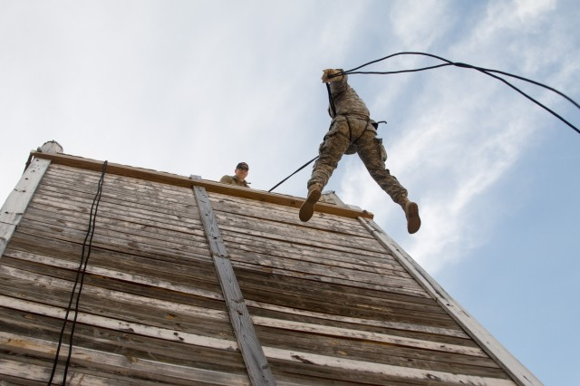 Spc. Casey with 171st Engineer Company, 105th Engineers Battalion, rappels down the wall at the mountaineering knots and rappelling event during the 2017 Sapper Stakes Invitational held at Camp Butner on April 8, 2017. The event brings together the engineer community to build leadership and camaraderie from across the state of North Carolina Guard and Reserve Component engineer units.