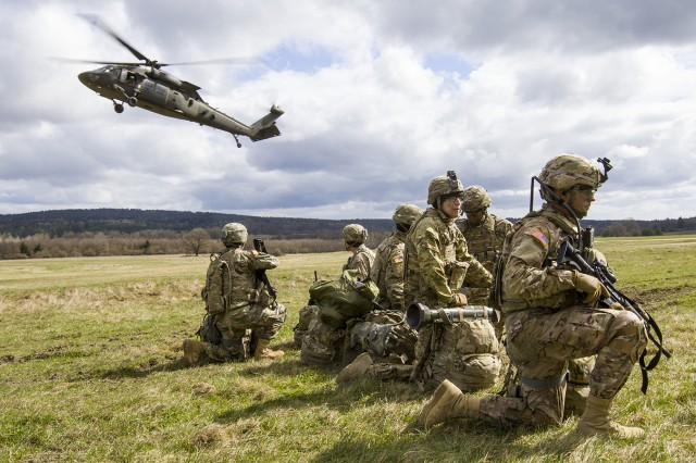 A UH-60 Black Hawk helicopter from A Company, 2nd Battalion, 10th Aviation Regiment, arrives Thursday at the pickup zone at Grafenwoehr Training Area, Germany. The aviators were taking part in a joint-training exercise with Soldiers from 3rd Squadron, 2nd Cavalry Regiment, in anticipation of working together during future Atlantic Resolve missions.
