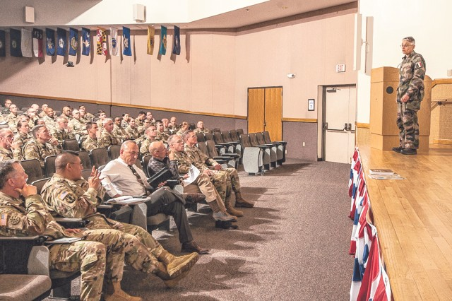 French Lt. Col. Valerie Grosse, French liaison officer, presented the French army organization and lessons learned from their ongoing operations in Africa during a quarterly leadership seminar held April 6 in Lincoln Hall Auditorium.