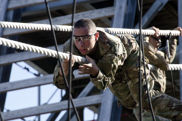 A Soldier with Bravo Company, 3rd Battalion, 34th Infantry Regiment, concentrates hard on sliding down a rope using a commando crawl during training at Fort Jackson's Victory Tower April 11. The Soldiers are in their first week of Basic Combat Training are learning the confidence needed in later stages of training. The Battalion is known as the Centennial Battalion because it will graduate during the post's Centennial Celebration in June.
