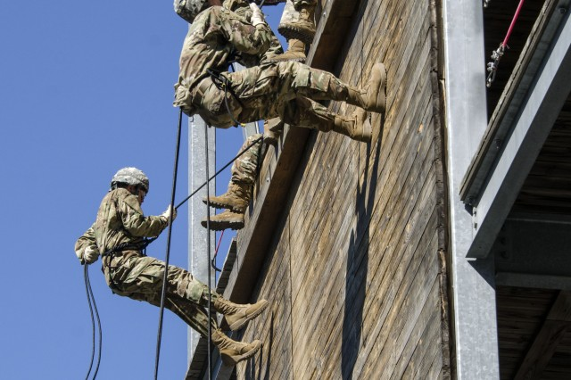 Soldiers in Training with Bravo Company, 3rd Battalion, 34th Infantry Regiment, repel down the side of  Fort Jackson's Victory Tower April 11. The Soldiers are in their first week of Basic Combat Training are learning the confidence needed in later stages of training. The Battalion is known as the Centennial Battalion because it will graduate during the post's Centennial Celebration in June.