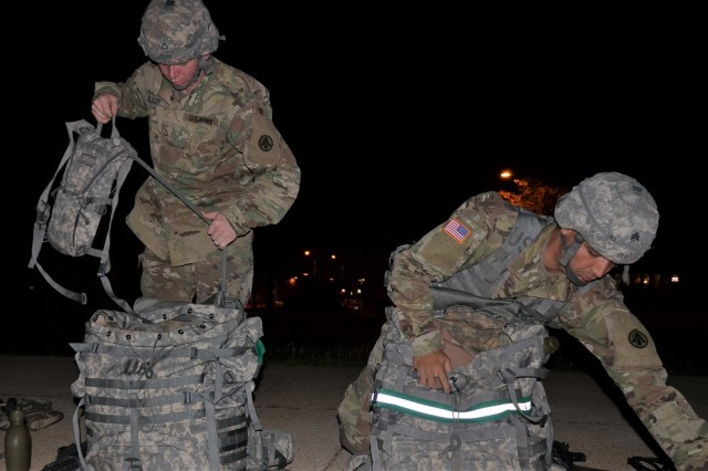Sgt. Luis Cruzsanchez and Pfc. Robert Nelson, 597th Transportation Brigade, prepare for a 12-mile ruck march just before 3 a.m. April 12 on the final day of the 2017 SDDC Best Warrior Competition at Fort Leonard Wood, Missouri.  Cruzsanchez and Nelson went on to sweep the BWC and both will represent the 597th and SDDC at the Army Materiel Command BWC in July.