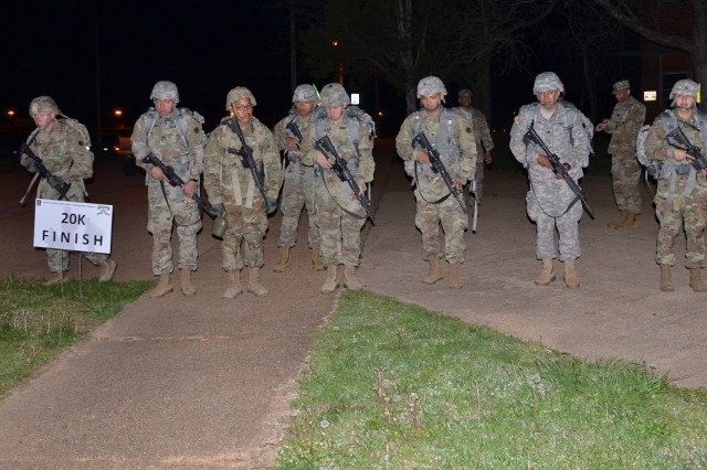 SDDC BWC competitors line up to begin a 12-mile ruck march at 3 a.m. April 12 -- the final day of the SDDC BWC competition at Fort Leonard Wood, Missouri. The march was immediately followed by a question-and-answer board as the competitors went from being tested physically to mentally.