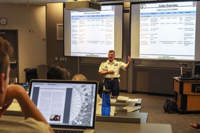 "Col. James ""Jim"" M. Chatfield, cyber director and deputy director of operations for the U.S. Army Reserve's 335th Signal Command (Theater) speaks to approximately 50 graduate students and Army Reserve Officer Training Corps cadets at the Scheller College of Business at the Georgia Institute of Technology in Atlanta, April 11, 2017.  Chatfield spent about 90 minutes discussing Army cyber capabilities and the future of cyber operations."