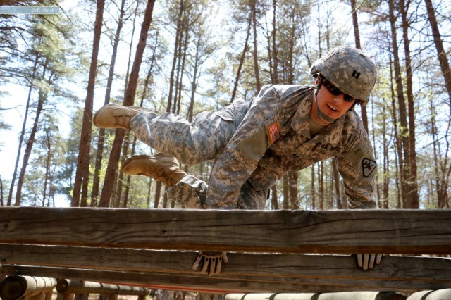 Capt. Keith McCarthy, 37, of Boston, who serves as a judge advocate with the 139th Legal Operations Detachment navigates the obstacle course during the U.S. Army Reserve Legal Command's Best Warrior Competition at Fort A.P. Hill, Virginia.