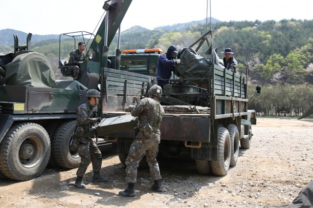 Soldiers from the 대한민국 육군 (Republic of Korea Army) 2nd Logistics Support Command load equpment into their K-511A1 2.5 ton cargo truck, April 13, 2017, in preparation for a supply convoy with 2ID Sustainment Brigade. The Combined Distribution Exercise is being conducted in support of exercise Operation Pacific Reach '17 to strengthen our alliance and interoperability with Republic of Korea allies. (U.S. Army photo by Sgt. Uriah Walker, 19th ESC Public Affairs)