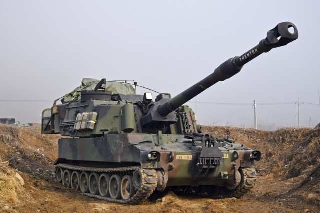YEONCHEON-GUN, South Korea -- An M109A6 Paladin artillery system from 1st Battalion, 5th Field Artillery Regiment, 1st Armored Brigade Combat Team, 1st Infantry Division, participates in a gunnery qualification training event in Yeoncheon-gun, South Korea March 28.  The training event gave battalion leadership the opportunity to evaluate and certify Paladin platoons.  (Photo by Capt. Jonathan Camire, 1st ABCT Public Affairs)