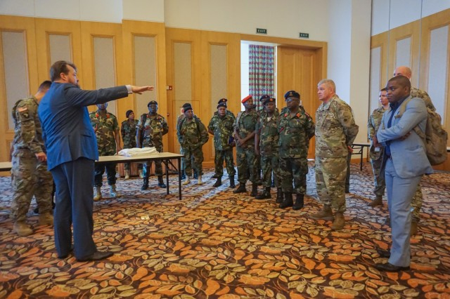 Bert Gillott, U.S. Army Africa protocol officer, briefs U.S. and Malawi military planners at the Bingu Wa Mutharika International Conference Center during the final planning event for the Africa Land Forces Summit 2017, Lilongwe, Malawi, March 27, 2017. ALFS is an annual, weeklong seminar bringing together land force chiefs from across Africa for candid dialog to discuss and develop cooperative solutions to regional and trans-regional challenges and threats.