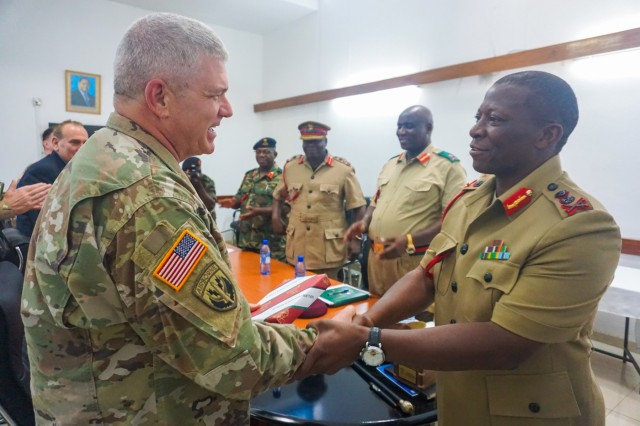 "U.S. Army Brig. Gen. Kenneth Moore, U.S. Army Africa deputy commander, shakes hands with Malawi Gen. Griffin ""Spoon"" Phiri, chief of Malawi Armed Forces, after a briefing at the Kumuzu Barracks, Lilongwe, Malawi, during the final planning event for the Africa Land Forces Summit 2017, March 27, 2017. ALFS is an annual, weeklong seminar bringing together land force chiefs from across Africa for candid dialog to discuss and develop cooperative solutions to regional and trans-regional challenges and threats."