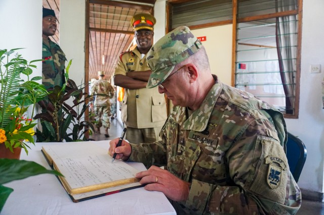 U.S. Army Brig. Gen. Kenneth Moore, U.S. Army Africa deputy commander, signs the guest book at the Malawi Armed Forces College near Salima, Malawi, during the final planning event for the Africa Land Forces Summit 2017, March 28, 2017. ALFS is an annual, weeklong seminar bringing together land force chiefs from across Africa for candid dialog to discuss and develop cooperative solutions to regional and trans-regional challenges and threats.