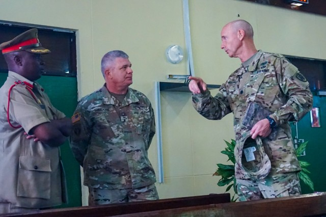 U.S. Army Lt. Col. Ed Williams, Defense Attache for the U.S. Embassy in Malawi, briefs Malawi Brig. Gen. Swithun Mchungula, commandant of the Malawi Armed Forces College, and U.S. Army Brig. Gen. Kenneth Moore, U.S. Army Africa deputy commander, at the Malawi Armed Forces College, Salima, Malawi, during the final planning event for the Africa Land Forces Summit 2017, March 28, 2017. ALFS is an annual, weeklong seminar bringing together land force chiefs from across Africa for candid dialog to discuss and develop cooperative solutions to regional and trans-regional challenges and threats.