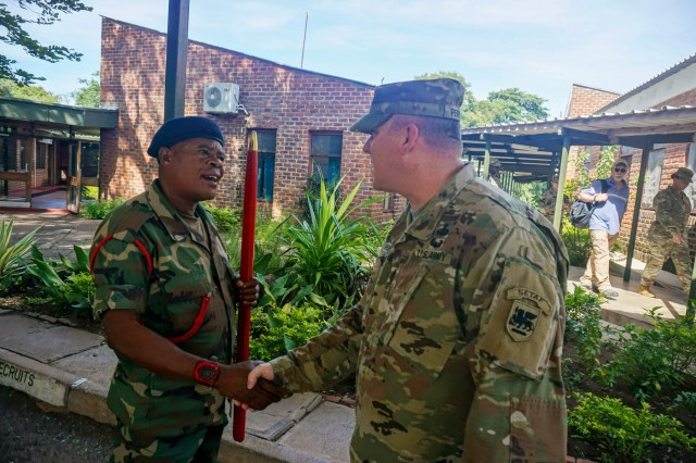 U.S. Army Africa Sgt. Maj. Scott Peirsol discusses planning details with his Malawi Defense Force counterpart at the Malawi Armed Forces College, Salima, Malawi, during the final planning event for the Africa Land Forces Summit 2017, March 28, 2017. ALFS is an annual, weeklong seminar bringing together land force chiefs from across Africa for candid dialog to discuss and develop cooperative solutions to regional and trans-regional challenges and threats.