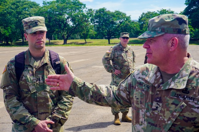 1st Lt. Christopher Bolin, aide to the U.S. Army Africa deputy commander, watches Brig. Gen. Kenneth Moore, U.S. Army Africa deputy commander, give a brief near the Malawi Armed Forces College, Salima, Malawi, during the final planning event for the Africa Land Forces Summit 2017, March 28, 2017. ALFS is an annual, weeklong seminar bringing together land force chiefs from across Africa for candid dialog to discuss and develop cooperative solutions to regional and trans-regional challenges and threats.