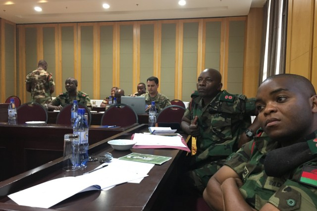 U.S. Army Africa and Malawi Defense Force planners receive briefings on scheduling, logistics and security concerns during the main planning event for the African Land Forces Summit 2017 in Lilongwe, Malawi, Dec. 5-9, 2016. ALFS is an annual, weeklong seminar bringing together land force chiefs from across Africa for candid dialog to discuss and develop cooperative solutions to regional and trans-regional challenges and threats. (Photo by U.S. Army Africa protocol officer Bert Gillott)
