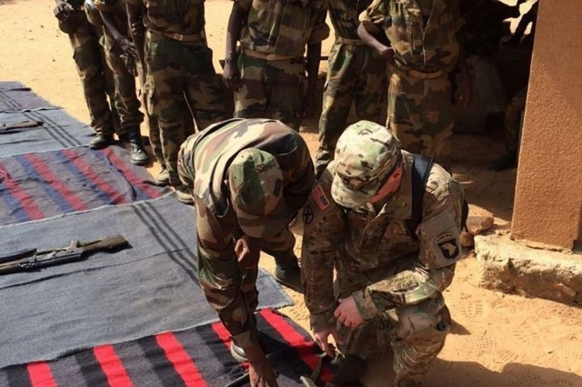 "Sgt. 1st Class Sean Carey shows a Nigerien Armed Forces (FAN) Instructor what he knows about the assembly and disassembly of the AK-47, the primary individual weapon for the units of the Nigerien Army. Other weapon systems the recruits learn about are the HKG3 and the PKM machine gun.Soldiers from the 2nd Battalion, 327th Infantry Regiment, of the 1st Brigade Combat Team ""Bastogne"", 101st Airborne Division (Air Assault), spent four weeks observing and mentoring basic combat training cadre of the FAN.The Bastogne Brigade is the regionally allocated force supporting U.S. Army Africa events and exercises across the African continent this year.Photo taken by Staff Sgt. Cameron Marsh."