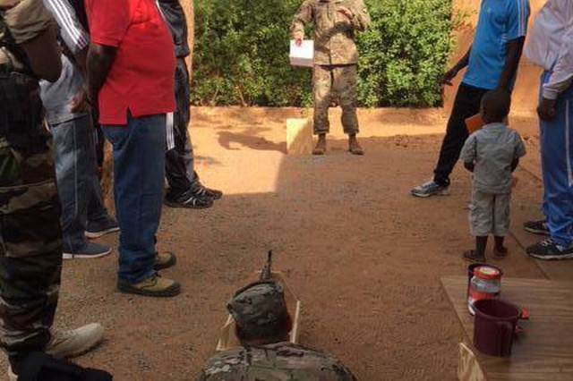"Sgt. 1st Class Sean Carey gives a block of instruction to the officers of the Nigerien Armed Forces (FAN) Basic Training on the proper way to utilize a shadow box while 1st Lt. Daniel Godlasky tries to maintain a steady aim. The shadow boxes, provided to the basic training school by the team from 2nd Battalion, 327th Infantry Regiment, of the 1st Brigade Combat Team ""Bastogne"", 101st Airborne Division (Air Assault), will be used as training aids to improve FAN recruit basic marksmanship abilitiesThe Bastogne Brigade team spent four weeks observing and making recommendations for improvement to the Nigerien basic training course.The Bastogne Brigade is the regionally allocated force supporting U.S. Army Africa events and exercises across the African continent this year.Photo taken by First Sgt. Peter Russell."