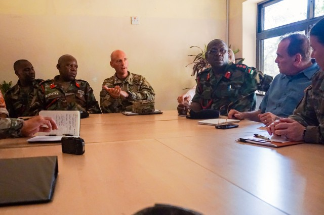 Malawi Defense Force Col. Cleveland Kachala and U.S. Army Lt. Col. Ed Williams, Defense Attaché to the U.S. Embassy in Malawi, receive an overview briefing about the Malawi Armed Forces College during the initial planning event for the African Land Forces Summit 2017 in Salima, Malawi, Oct. 19, 2016. ALFS is an annual, weeklong seminar bringing together land force chiefs from across Africa for candid dialog to discuss and develop cooperative solutions to regional and trans-regional challenges and threats.