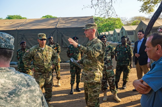 U.S. Army Lt. Col. Ed Williams, Defense Attaché to the U.S. Embassy in Malawi, talks about the history of the peacekeeping training center at the Malawi Armed Forces College during during the initial planning event for the African Land Forces Summit 2017 in Salima, Malawi, Oct. 19, 2016. ALFS is an annual, weeklong seminar bringing together land force chiefs from across Africa for candid dialog to discuss and develop cooperative solutions to regional and trans-regional challenges and threats.