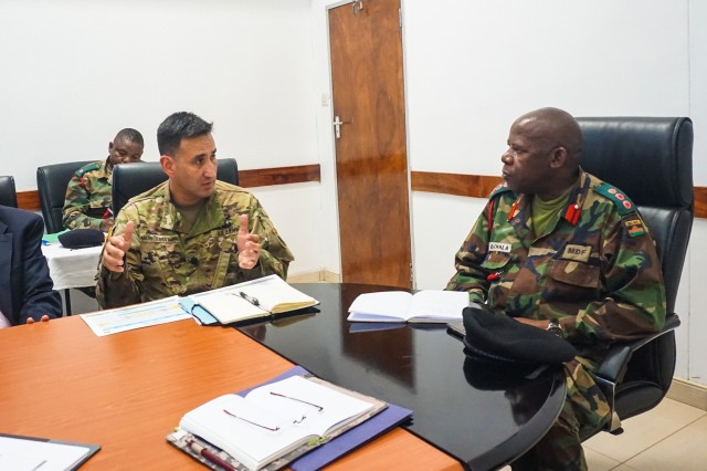 U.S. Army Africa lead conference planner Lt. Col. Hector Montemayor discusses a proposed timeline of events with Malawi Defense Force Col. Cleveland Kachala during the initial planning event for the African Land Forces Summit 2017 in Lilongwe, Malawi, Oct. 18, 2016. ALFS is an annual, weeklong seminar bringing together land force chiefs from across Africa for candid dialog to discuss and develop cooperative solutions to regional and trans-regional challenges and threats.