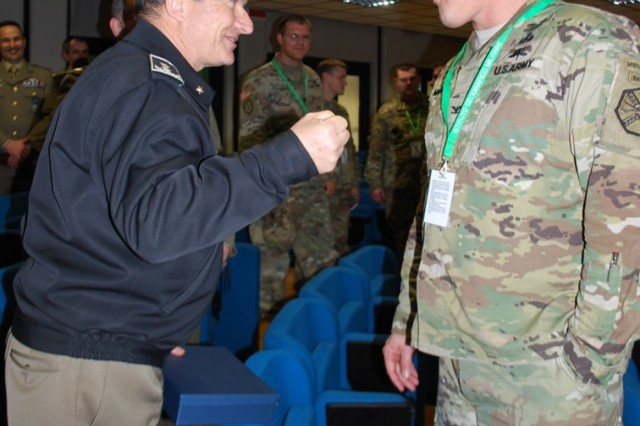 Italian Army Maj. Gen. Gianfranco Rossi (right), commander of the Istituto Geografico Militare (Military Geographic Institute), and Col. Steve Marks, U.S. Army Garrison Italy commander, exchange ideas during a professional development visit and partner nation engagement in Florence March 23.