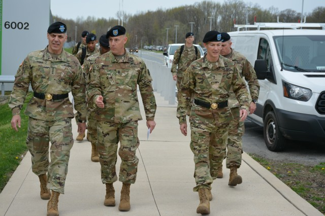 ABERDEEN PROVING GROUND, Md. (April 13, 2014) - (Left to right) Gen. Gus Perna, Commanding General of Army Materiel Command (AMC), Communications-Electronics Command (CECOM) Command Sgt. Maj. Matthew McCoy, and incoming CECOM CG, Maj. Gen. Randy Taylor, as they proceed to the CECOM Change of Command ceremony here today.