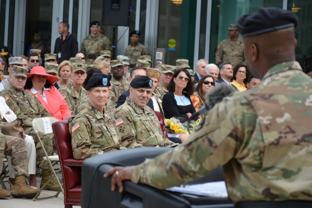 ABERDEEN PROVING GROUND, Md. (April 13, 2014) - Outgoing Communications-Electronics Command (CECOM) CG, Maj. Gen. Bruce Crawford addresses the audience as, (front, L-R), incoming CECOM CG, Maj. Gen. Randy Taylor, and Gen. Gus Perna, Commanding General of Army Materiel Command (AMC), listen intently, during the CECOM Change of Command ceremony here today.