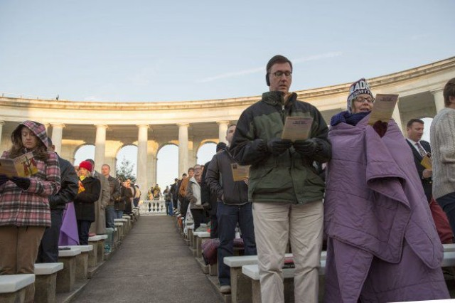 Hundreds of visitors to Arlington National Cemetery's Memorial Amphitheater watch the sunrise during the annual Easter Sunrise Service, April 5, 2015. This year's Easter Sunrise Service takes place April 16.
