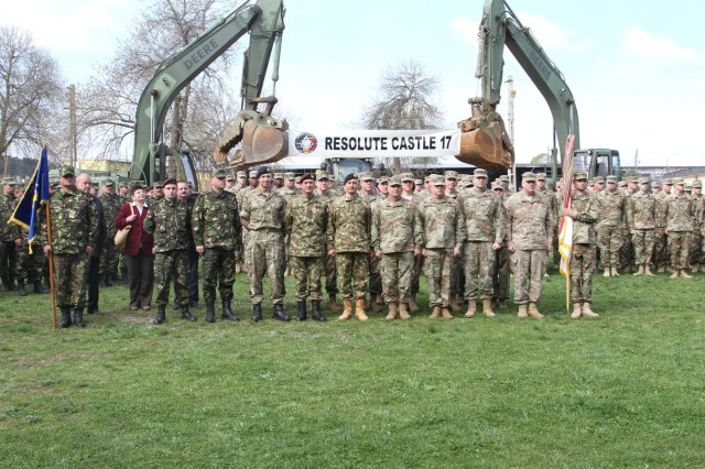 The collaborative leadership team at Cincu Training Area, Romania poses for a group photo in front of combined forces as they conclude the opening ceremony to Resolute Castle 2017 on April 14. The exercise allows a combined contingent of engineers to learn from one another and create a cohesive support element for Operation Atlantic Resolve, a NATO mission involving the U.S. and Europe in a combined effort to enhance regional stability and deter aggression. (Photo by Army Pvt. Nicholas Vidro, 7th Mobile Public Affairs Detachment)