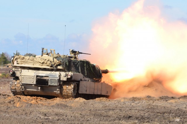 Soldiers from Company C (Chaos), 1st Battalion, 68th Armor Regiment, 3rd Armored Brigade Combat Team, 4th Infantry Division, Fort Carson, Colo., fire from a M1A2 Abrams on a range in Adazi Military Base, Latvia, April 14.  The platoon live fire is the last exercise before Operation Summer Shield begins.  The brigade is deployed to eastern Europe under Operation Atlantic Resolve, a U.S. led NATO endeavor to promote peace in the region by deterring aggressive actions.  (U.S. Army photo by Sgt. Shiloh Capers)