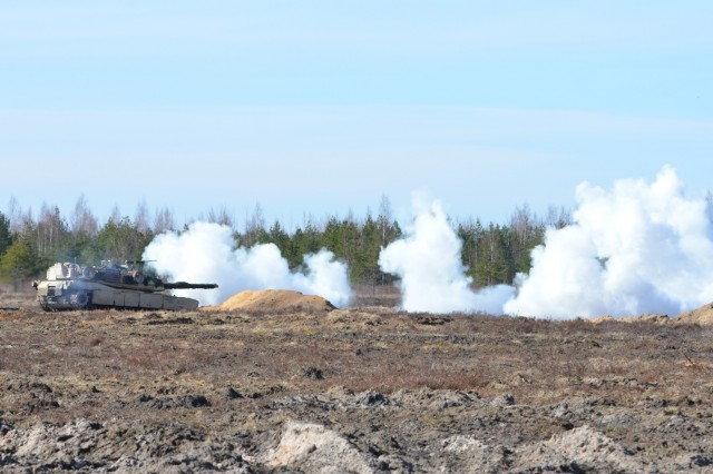 Soldiers from Company A, 1st Battalion, 68th Armor Regiment, 3rd Armored Brigade Combat Team, 4th Infantry Division, Fort Carson, Colo., M1A1 Abrams fires smoke grenades to conclude the platoon live-fire.  The platoon live-fire is the last exercise before exercise Summer Shield begins. The brigade is deployed to eastern Europe under Operation Atlantic Resolve, a U.S. led NATO endeavor to promote peace in the region by deterring aggressive actions. (U.S. Army photo by Sgt. Shiloh Capers)