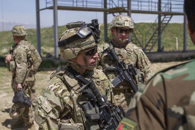 Maj. Carmen Bucci, TF Spartan operations officer, speaks with Afghan National Army Commanders at a Joint Combat Out Post on May 16th. The JCOP hosts Afghan National Security Forces in Rabat, Parwan, Province, Afghanistan who partner with Coalition Forces.