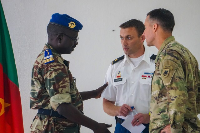 U.S. Army Maj. Tom Brooks, U.S. Embassy Youande security cooperation chief, and Col. Michael Zinno, U.S. Army Africa G9 Director, are briefed on the schedule prior to the opening ceremony for the Unified Focus 2017 initial planning event (IPE), Douala, Cameroon, Oct. 11, 2016. The UF17 IPE brought partner nation planners together for the first time to discuss and begin shaping the inaugural Unified Focus exercise designed to enhance and enable Lake Chad Basin Commission nations to support the Multinational Joint Task Force (MNJTF) counter-Boko Haram operations.
