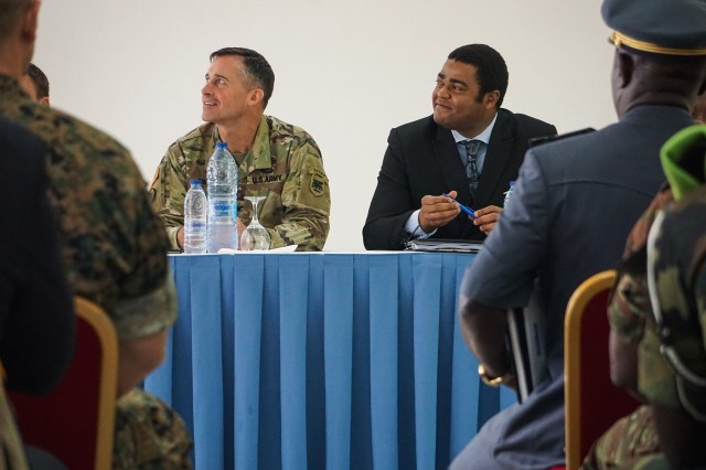 Col. Michael Zinno, U.S. Army Africa G9 Director, and Ludovic Etienne Ngwba, Secretary General in the Littoral Governor's Office, listen to opening remarks during the opening ceremony for the Unified Focus 2017 initial planning event (IPE), Douala, Cameroon, Oct. 11, 2016. The UF17 IPE brought partner nation planners together for the first time to discuss and begin shaping the inaugural Unified Focus exercise designed to enhance and enable Lake Chad Basin Commission nations to support the Multinational Joint Task Force (MNJTF) counter-Boko Haram operations.