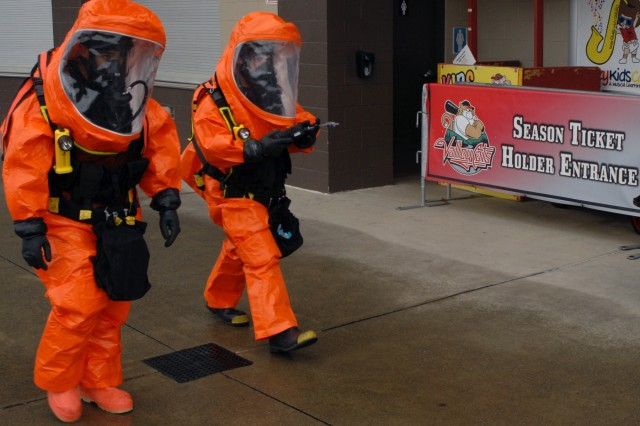 2nd Civil Support Team (CST) members Sgt. Christopher Rodriguez (left) and Staff Sgt. Joshua Spagnola (right) move toward a mock WMD laboratory during the 2nd CST's training exercise at Joseph L. Bruno Stadium in Troy, N.Y. on April 12, 2017. Team members are trained to identify chemical, biological, and radiological agents and advise first-responders on how to deal with these materials.