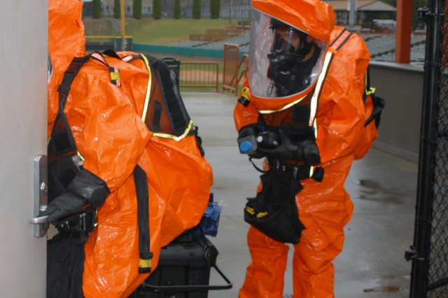 2nd Civil Support Team (CST) members Staff Sgt. Joshua Spagnola and Sgt. Christopher Rodriguez enter a mock WMD laboratory during the 2nd CST's training exercise at Joseph L. Bruno Stadium in Troy, N.Y. on April 12, 2017. Team members are trained to identify chemical, biological, and radiological agents and advise first-responders on how to deal with these materials.