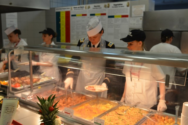 Lt. Col. Tracey Smith, garrison commander of Camp Mihail Kogalniceanu and Novo Selo Training Area, serves Easter holiday meals to U.S. service members and civilians deployed to Romania.