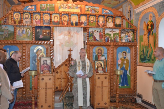 U.S. Army Chaplain (Lt. Col.) Michael Crawford, head of the Religious Support Team at Mihail Kogalniceanu Air Base, Romania, speaks to the assembled worshippers during an Easter sunrise service at the Romanian Eastern Orthodox chapel on the base, April 16. Service members had gathered for the early morning chance to worship together, sing hymns, and remember family and friends observing the holiday back in the United States.