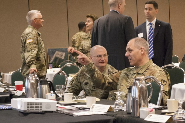 Gen. Gustave Perna, commanding general of U.S. Army Materiel Command, and Maj. Gen. Edward Daly, commanding general of the U.S. Army Sustainment Command, discuss ASC's future plans and goals during a Senior Leaders Forum at the Radisson Hotel, Davenport, Iowa, March 29.