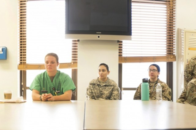Capt. Kelly Elmlinger (left), an Army nurse and cancer survivor, speaks to nurses of William Beaumont Army Medical Center's Surgical Ward, during a visit to the ward where she shared her experience during her fight with synovial sarcoma, a rare soft-tissue cancer, and recovering through limb salvage and amputation, April 6. Elmlinger, who is coaching and mentoring wounded warriors during this year's Department of Defense Warrior Games, visited with staff members to help them understand the impact WBAMC staff can have on patients.
